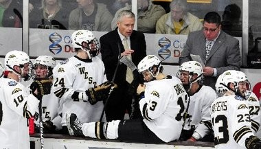 Western Michigan hockey coach Andy Murray talks to his team during a game last season.