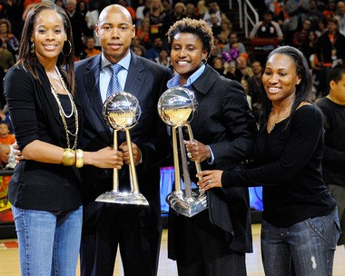 Tangela Smith (left) and Temeka Johnson along with coaches Cory Gaines and Bridget Pettis holding WNBA Championship trophies.