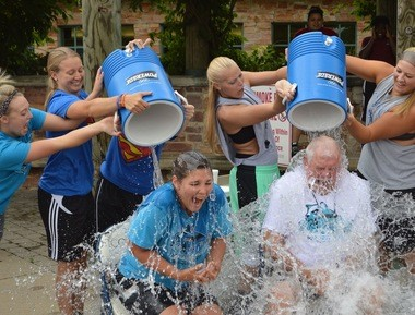 KVCC women's basketball coach Ron Welch (right) and assistant coach Maureen Brown get a dousing from their team as part of a #Chillin4Charity cold-water challenge on July 8, 2014.