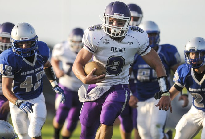 Swan Valley senior Alex Grace (9) runs the ball during a game against Nouvel Catholic Central on Thursday, Aug. 28, 2014. (File | MLive.com)