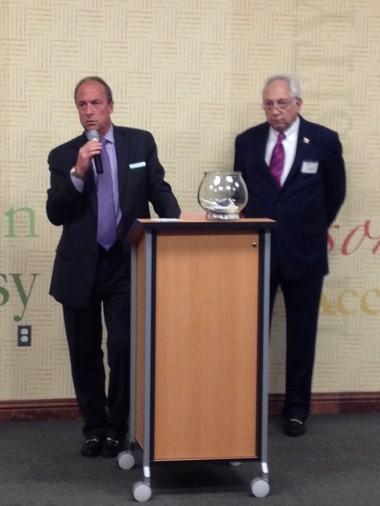 Huntington Bank East Michigan President Michael Fezzey and WJR radio host Paul W. Smith