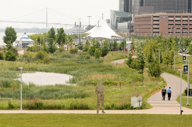 This stretch of RiverWalk overlooking Rivard Plaza features the handcrafted and Detroit-themed Cullen Family carousel, the Detroit Princess Riverboat, artist John Sauve's 'Man in the City' and the skyline of the General Motors Renaissance Center. Natural plants and prairie grasses and a pond make up the green space helping with storm water management and creating a environment for wildlife. (Tanya Moutzalias | MLive.com)