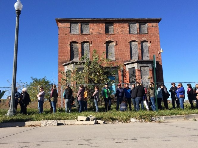 The next home down the block from the Ransom Gillis home at 205 Alfred St. in Detroit. The line seen in front of the house was there for the Nicole Curtis open house Nov. 1, 2015. (Ian Thibodeau)
