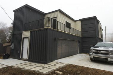 The two-car garage is built from two shipping containers. (Tanya Moutzalias | MLive Detroit)