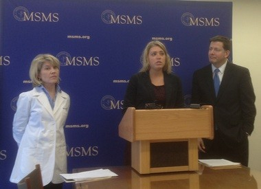 Anne Goulet, center, talks about her experience with indoor tanning and being diagnosed with melanoma during a press conference at the Michigan State Medical Society headquarters on Thursday. She joined Dr. Kay Watnick and Rep. Jim Townsend in supporting legislation to ban minors from using indoor tanning facilities.