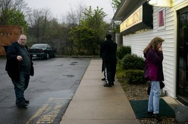 Patrons smoke outside of Avenue Billiards in Jackson in this 2012 file photo.