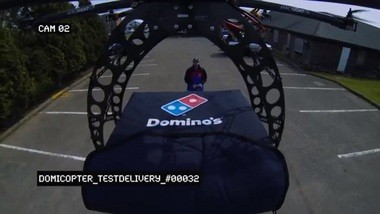 "The ""DomiCopter"" can be seen delivering pizzas by air in this video screenshot from Domino's Pizza UK and Ireland Ltd."