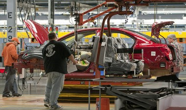 Workers at General Motors Co.'s Orion Assembly Plant.