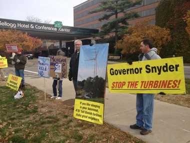 More than 20 people protested outside of the American Wind Energy Association's State Energy Forum on Monday, arguing that wind turbines are disruptive and destroy neighborhoods.
