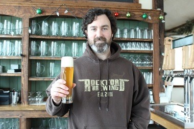 Jeff Sheehan of Rockford Brewing Company in Kent County serves White Pine Wheat, made with Michigan hops and wheat (courtesy photo)