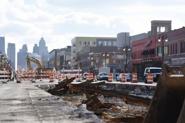 Old rail lines are exposed on Woodward Ave. to be torn out as construction of the M-1 Rail Line moves north into Detroit's Midtown Wednesday Dec. 31, 2014.