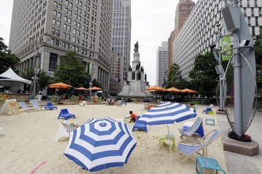 In this June 23, 2014, photo, a beach scene is displayed at Campus Martius in Detroit. Campus Martius is a 1.6-acre park where the historic Woodward and Michigan avenues converge. It opened in 2004 after several years of plans and more than $20 million in donations.