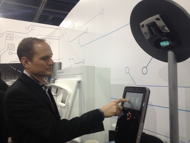 Rodger Eich, Johnson Controls Inc. director of industrial design for automotive electronics and interiors, shows the company's new infotainment system during the 2013 CES in Las Vegas on Wednesday, Jan. 3. The system will debut in vehicles beginning in the 2015 model year.