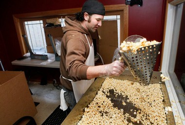 Paul Clara of Grand Rapids stirs salt into a hot batch of Dorothy & Tony's Kettle Corn at the Plainfield shop on Feb. 22, 2012.