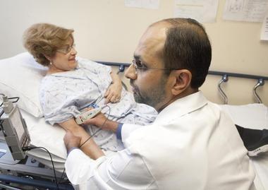 Dr. Muhammed Umar Farooq, a neurologist, performs electrodiagnostics on Nancy Campau at Saint Mary's Health Care.