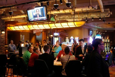 Visitors enjoy the gaming tables Monday at the new Four Winds Casino Dowagiac. Monday was the first day of gaming, open to tribal members of the Pokagon Band of Potawatomi Indians. The tables are near the center of 12,000 square feet of gaming space.