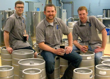 From left: Big Lake Brewing owners Nic Winsemius, Greg Mackeller, Travis Prueter. The new Holland Township brewery opens July 5 at noon.