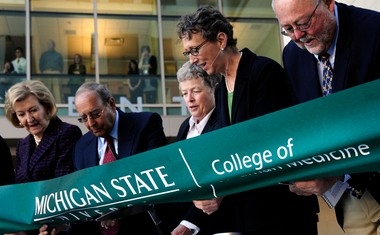 Michigan State University officials and local benefactors including Peter Secchia, right, and Dean Marsha Rappley, cut the ribbon of the Secchia Center College of Human Medicine in this Sept. 2010, file photo.