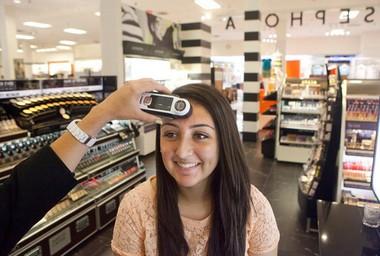 Bella Carpio has a Sephora + Pantone Color IQ test done by Amy Davis, a Sephora beauty leader, on Thursday, June 20, at Sephora in the Woodland Mall. (Emily Zoladz | Mlive.com)