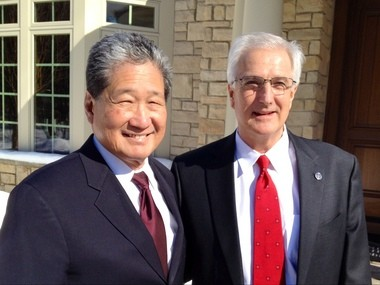 Earl Lee, chief executive officer of HSF Affiliates LLC, left, stands Wednesday with Steven Fase, chief executive officer and owner of Berkshire Hathaway HomeServices Michigan Real Estate.