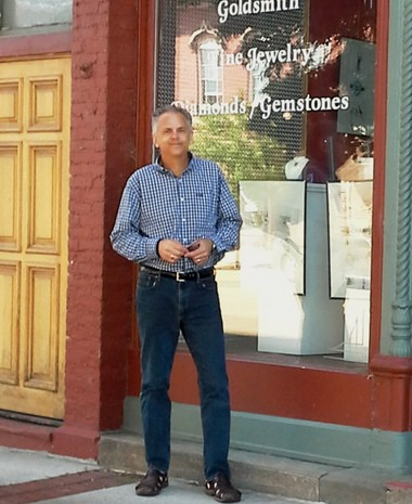 """"""" alt=""""Cliff Yankovich in front of his 12-year-old jewelry store, Chimera Design, in Lowell."""
