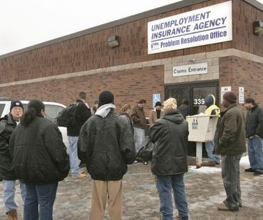 People wait for hours to get into the packed unemployment insurance agency office on Plainfield Ave NE in this file photo.
