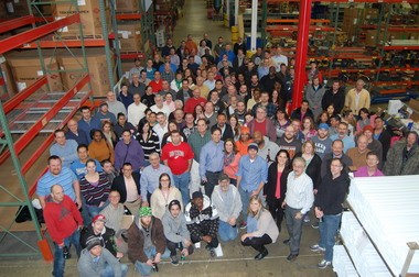 Custom Profile's Grand Rapids workforce gather after the company's best workplace award.
