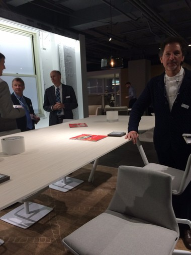 Coalesse General Manager Lew Epstein stands next to one of the firm's higher tables that can be customized to be bar height for standing meetings.