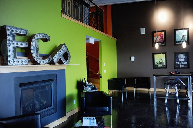 Extra Credit Project's new 4,000 square-foot office off U.S. 131 is an open work environment with a fireplace.
