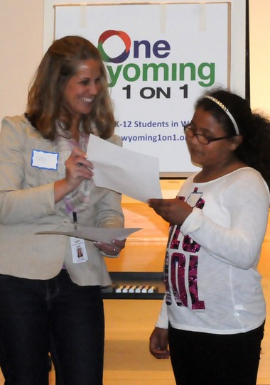 Mentor Betsy Berry, a Team 21 coordinator at West Godwin Elementary School, talks about her relationship built throughout the year with her mentee, Janissa Rawls, a fourth-grade student at West Godwin, during the One Wyoming 1 on 1 celebration at the Wyoming branch of the Kent District Library, 3350 Michael Ave. SW.