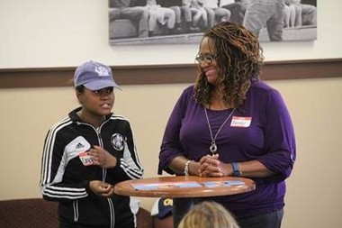 Brooke Davis and her mentee, Imani Hayden, celebrate the success of the One Wyoming 1 on 1 mentoring program during the recent annual end-of-the-year celebration held at Grace Bible College, 1011 Aldon St. SW.