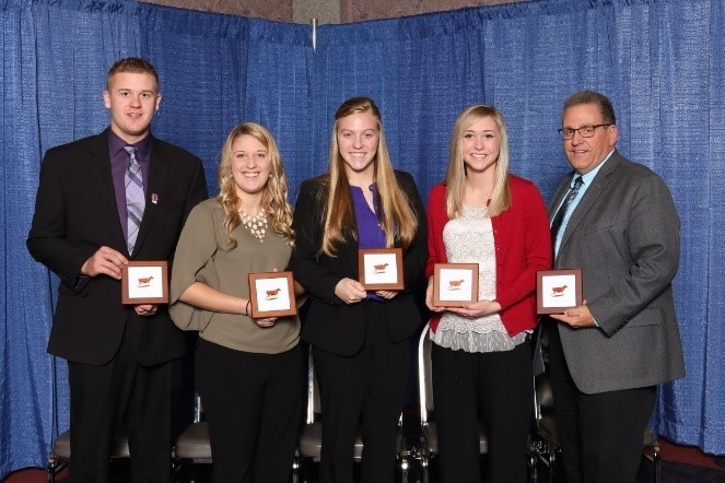 Michigan State University's Two-Year Junior College Division Dairy Cattle Judging Team poses with some plaques after competing at the North American International Livestock Exposition in early November. From left to right: Gerrit Baker, Kristen Burkhardt, Miriah Dersham, Rebeka McDonald and coach Joe Domecq.
