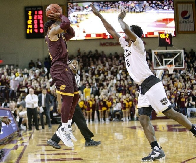 CMU's Marcus Keene takes a step-back 3-pointer over WMU's Thomas Wilder during his 35-point night in an 86-82 win Feb. 3 at McGuirk Arena.
