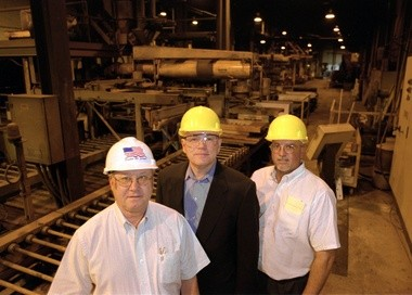 This is a photo of the executives of Michigan Steel at the time of the Muskegon plant's purchase from bankruptcy in 2002. Left to right, Gary D. Counselor, executive vice president, Vaughn W. Makary, owner and chief executive officer and Jim Perreault, vice president of manufacturing.