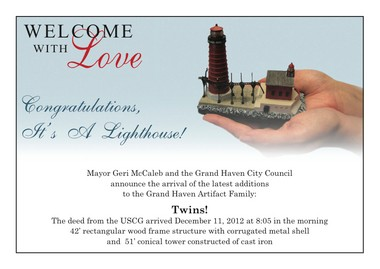 The Grand Haven Lighthouse Conservancy sent out a birth announcement to lighthouse stakeholders to acknowledge and commemorate the city's official ownership of the structures.