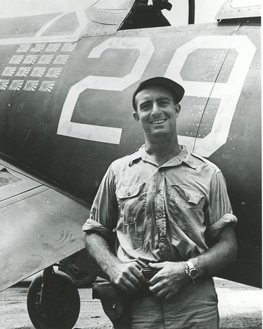 """Muskegon's Ira Cassius """"Ike"""" Kepford pictured next to his F4U in the southwest Pacific showing 16 enemy planes shot down."""