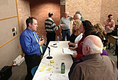 Adam Wygant, a section supervisor with the Michigan DEQâs office of oil, gas and minerals talks with attendees of an informational meeting at Muskegon Community College on Wednesday, May 1.