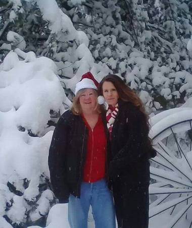 "Tanya Long, left, and her daughter, Amy ""Blizzard Hawk"" Theodore, are shown in a recent photo. Long gave birth to Theodore during the Blizzard of '77."