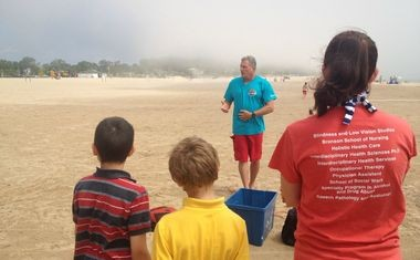 Bob Pratt, executive director of education for Great Lakes Surf Rescue Project, talks about the proper protocol to save a person from drowning on Sunday, June 22, 2014 at Pere Marquette Beach.