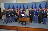 State Rep. Jon Bumstead, R-Newaygo, joins Rep. Ray Franz, R-Onekama, and Gov. Rick Snyder at the signing of Public Act 441, a new law naming a portion of M-116 in Mason County after fallen State Police Trooper Paul Butterfield. In attendance were Trooper Butterfield's fiance, Jennifer Sielski; his stepmother Pat Butterfield; and members of the state police and the Mason County sheriff's department.