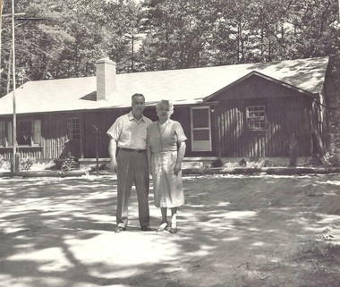 """""""Aces of Diamonds"""" is the name Jack Bursey and his wife Ada chose for their log home and general store near Montague. They're shown here out front in the summer of 1958."""