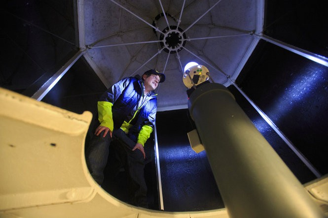 MLive Muskegon Chronicle reporter Brandon Champion takes an up-close look at the LED light that lights up Big Sable Point Light at Ludington State Park in Ludington, Mich. on September 29, 2015.