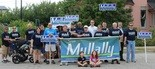 Sean Mullally poses with his volunteer team during a September event.