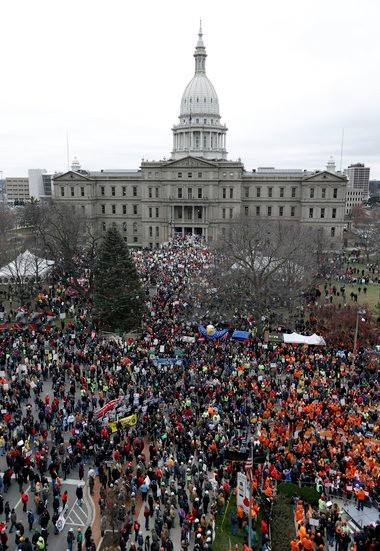 Protesters gather for a rally at the State Capitol in Lansing Dec. 11, 2012. Our columnist points out how unions are trying to work around the new law.