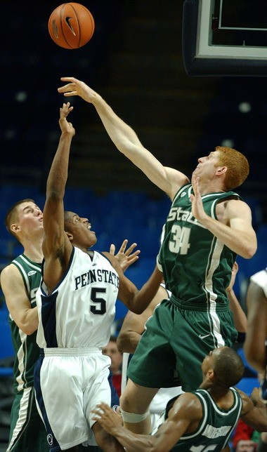 MSU's Drew Naymick goes up to swat a shot against Penn State.
