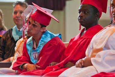 Mohammed Al-Saadi, left, blows on his tassel during Albion High School's class of 2013 graduation ceremony at Goodrich Chapel on the campus of Albion College on Friday, May 24. The school had 40 graduating seniors participate in the ceremony. (Mike Mulholland | MLive.com)