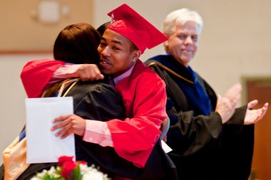 Ulysses Lacy receives his diploma during Albion High School's class of 2013 graduation ceremony at Goodrich Chapel on the campus of Albion College on Friday, May 24. The school had 40 graduating seniors participate in the ceremony. (Mike Mulholland | MLive.com)