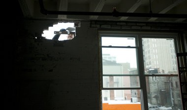 A hole is made for a new window as apartments are currently being built at 159 W. Pearl Street in downtown Jackson by NC Development Group. The Anchor Initiative aims to provide affordable, market-rate housing for professionals in downtown Jackson.