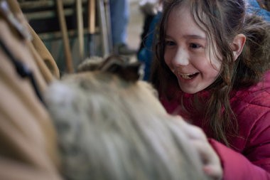 Abigail Pindzia, right, pets a rabbit during Project RED on Tuesday, March 25, 2013 at the Jackson County Fairgrounds. (Michelle Tessier | MLive.com)