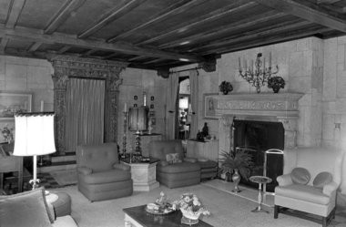Travertine walls and floor and a beamed ceiling mark the Italian castle room in the Arthur C. Bloomfield home at 750 W. Michigan Ave., pictured here in 1975, when it was the residence of Dr. and Mrs. Laurence E. Allen. (File and courtesy photos | MLive.com)
